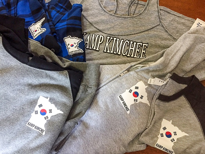 Kamp Kimchee Apparel including sweatshirts and tank tops