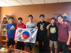 Group of boy students with flag