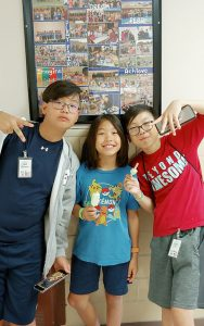 Three students enjoying icecream at Kamp Kimchee
