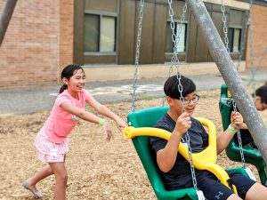 Students swinging