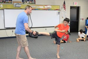 Boy students doing taekwondo