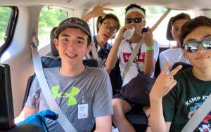 Five boy camp members in the van at Kamp Kimchee
