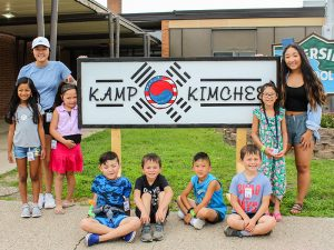 Violet's Class at Kamp Kimchee in front of the sign